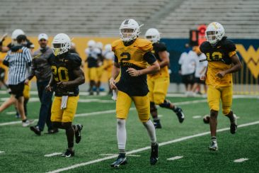 Left to right: running back Alec Sinkfield, quarterback Jarret Doege and receiver Ali Jennings. WVU Athletics