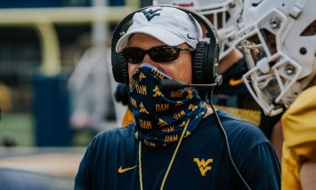 Head coach Neal Brown wearing a mask at practice