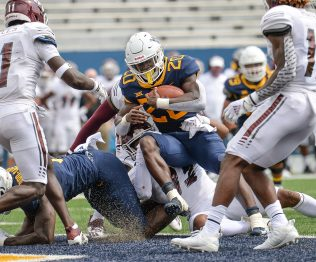 West Virginia Mountaineers running back Alec Sinkfield (20) rushes in for a touchdown against Eastern Kentucky Colonels during an NCAA football game on Saturday, September. 12, 2020, in Morgantown, West Virginia.