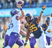 West Virginia Mountaineers defensive lineman Dante Stills (55) rushes TCU Horned Frogs quarterback Max Duggan (15) on Saturday, Nov. 14, 2020, in Morgantown, W.Va.