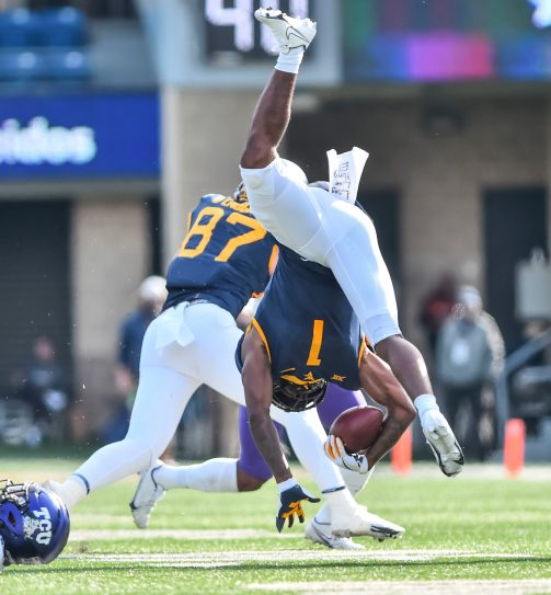 West Virginia Mountaineers wide receiver T.J. Simmons (1) is tackled by TCU Horned Frogs safety Ar'Darius Washington (24) on Saturday, Nov. 14, 2020, in Morgantown, W.Va.