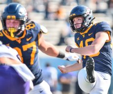 West Virginia Mountaineers place kicker Casey Legg (48) hits a extra point against TCU Horned Frogs on Saturday, Nov. 14, 2020, in Morgantown, W.Va.
