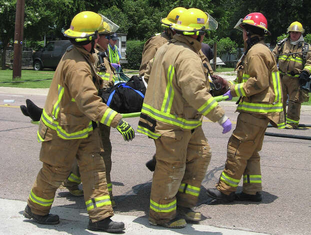 firefighters at accident