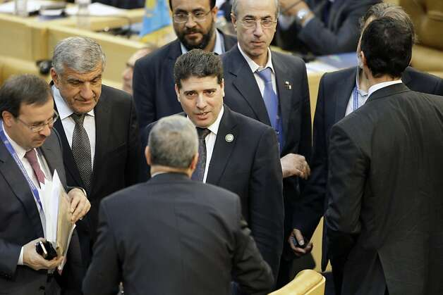 Syria's prime minister, Wael Nader al-Halqi, center, arrives at conference hall of Nonaligned Movement summit in Tehran, Iran, Friday, Aug. 31, 2012. (AP Photo/Vahid Salemi) Photo: Vahid Salemi, Associated Press / SF