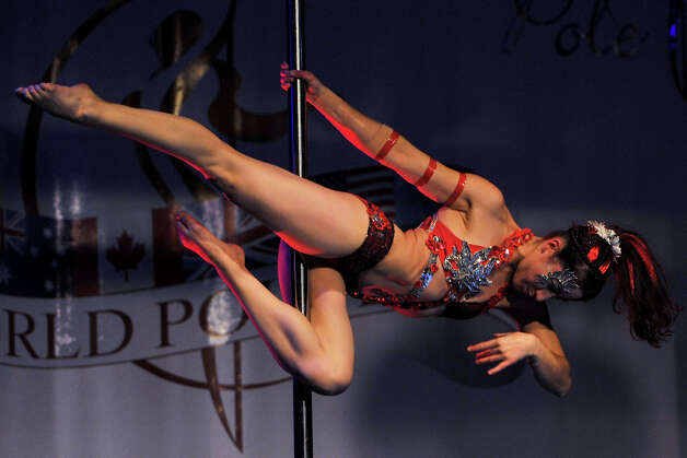 A competitor participate at the World Pole Dancing Championship 2012 held at the Volkshaus on November 10, 2012 in Zurich, Switzerland. Photo: Harold Cunningham, Getty Images / 2012 Getty Images