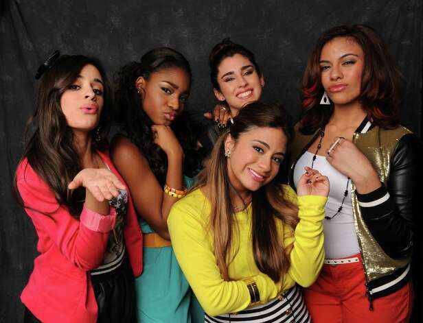 "Fifth Harmony, featuring S.A. native Ally Brooke (in yellow shirt), is in the final four on the current season of ""The X Factor."" Photo: Fox / San Antonio Express-News"