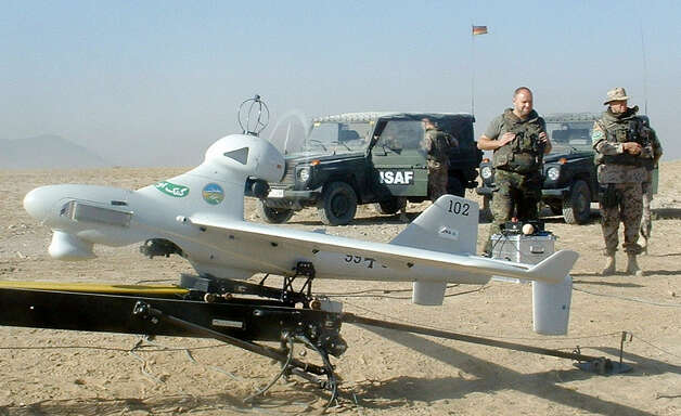 German soldiers stand next to a drone prior to its launch north of Kabul, Afghanistan on Oct. 14, 2003. Photo: AFP, AFP/Getty Images / 2003 AFP