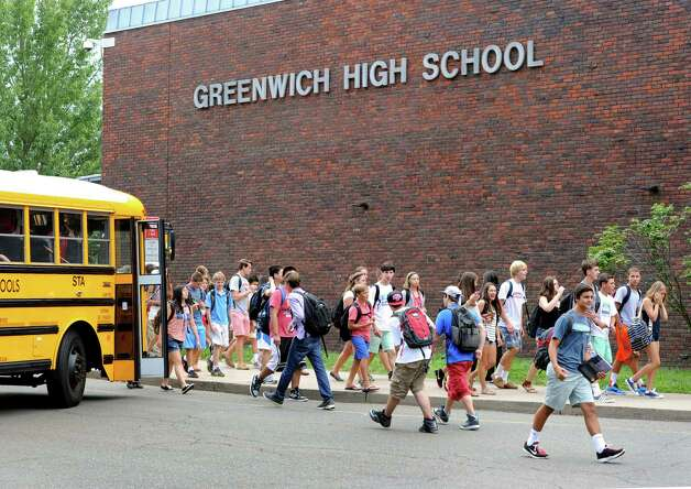 "Greenwich High School students during dismissal, Wednesday afternoon, August 28, 2013. A Greenwich High School sophomore, widely reported to have been the victim of bullying, committed suicide after the first day of classes Tuesday. Bartlomiej ""Bart"" Palosz, 15, shot himself to death Tuesday night at his family's home in Byram, police said. Photo: Bob Luckey / Greenwich Time"