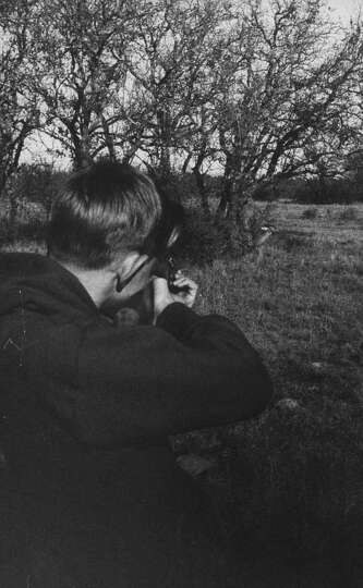 Boy shooting deer, 1960.