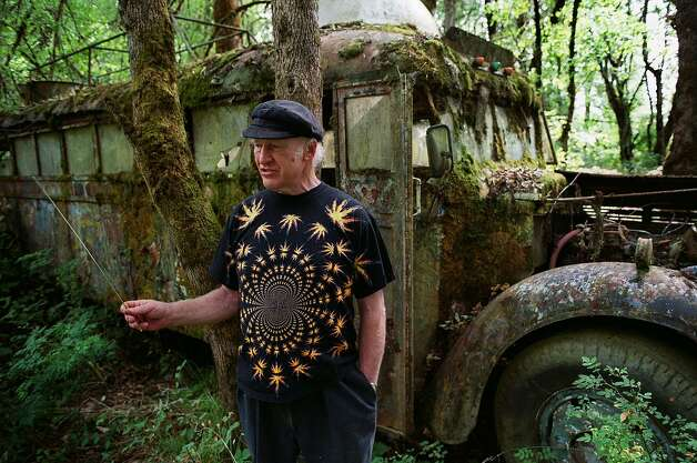 Ken Kesey stands next to the overgrown Merry Pranksters bus on his Oregon property months before his death in 2001. Photo: Brian Davies, AP