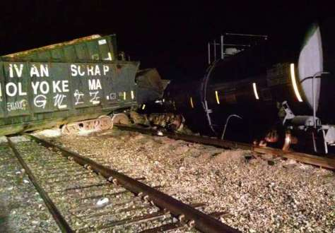 Railcars are derailed Wednesday night, Oct. 23, 2014, at the CSX yard in Selkirk, N.Y. (Sheriff Craig Apple)