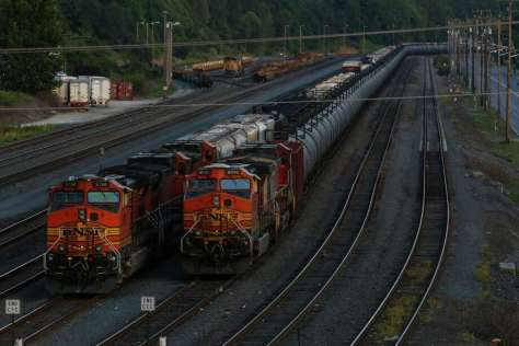 A train hauls crude oil in Seattle last month. Railroads and regulators can leverage technology to make existing inspection programs more efficient and effective, says a white paper by the Alliance for Innovation and Infrastructure.on Wednesday, July 15, 2015. The highly controversial trains haul rail cars loaded with oil brought from the oil fields of North Dakota and Montana. (Joshua Trujillo, seattlepi.com) Photo: JOSHUA TRUJILLO / SEATTLEPI.COM
