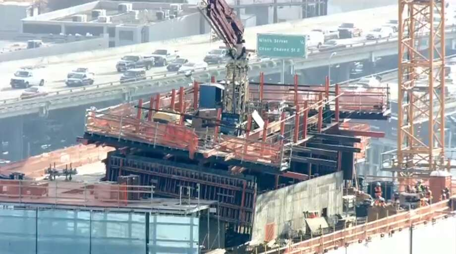 A malfunctioning crane threatened to unleash a 2,000 pound concrete slab from the 30th floor of 41 Tehama St., officials said. Photo: Video Frame Grab Via KTVU