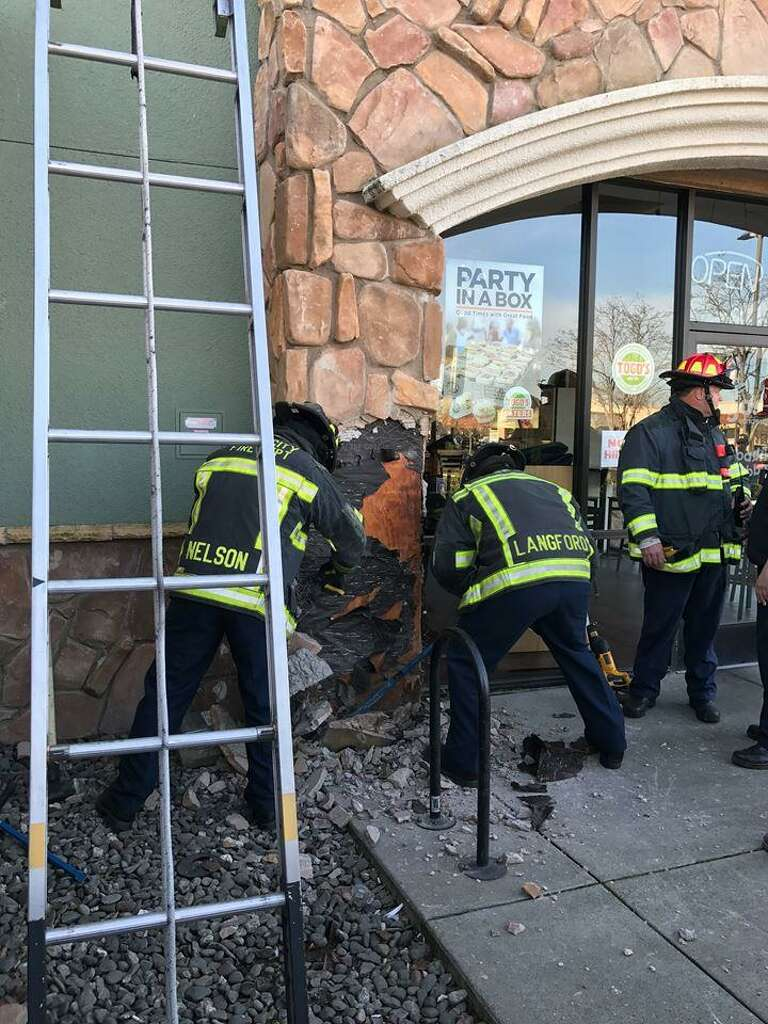 A man was found naked, stuck in a shaft above a sandwich shop in Napa early Tuesday morning, officials said.