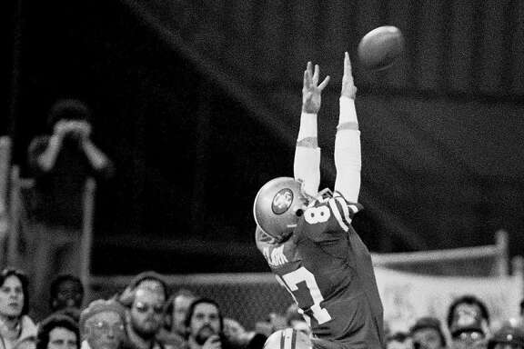"SF 49ERS DWIGHT CLARK MAKING "" THE CATCH "" 49ERS VS. DALLAS COWBOYS, 10 JAN82, 1981 NFC championship game in San Francisco.  Photo by John Storey/ San Francisco Examiner/Bancroft Library"