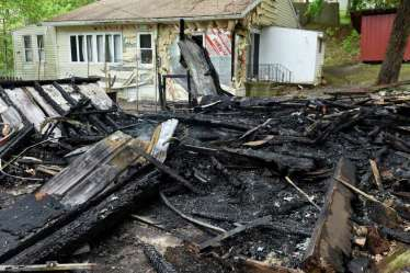 The smoldering remains of a building on Cold Spring Road on Monday, May 15, 2017, in Schodack, N.Y. Authorities said someone set fire to the structure on Sunday and the fire is considered a hate crime. Schodack police do not identify the race or religion of the homeowners but a source says the victims are black. (Will Waldron/Times Union) Photo: Will Waldron / 20040517A