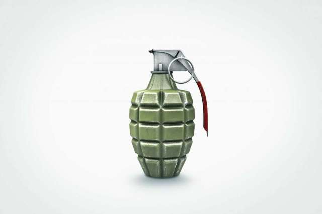 FILE PHOTO: Close up of grenade. Photo: Chris Clor/Getty Images/Blend Images
