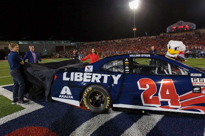 NASCAR driver William Byron unveils new No. 24 Liberty University car at LU Homecoming
