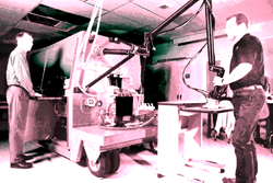 Two engineers working with an industrial pulsed laser system
