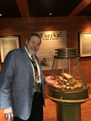 "Michael Fuljenz, President of Universal Coin & Bullion in Beaumont, Texas, with some of the historic California Gold Rush assayers' ingots recovered from the fabled ""Ship of Gold,"" the SS Central America."