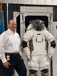 Fran DiNuzzo, ILC Dover CEO, with ILC Dover's Astro™ EVA spacesuit