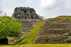 The ancient Maya temple of Xunantunich surrounded by greenery and blue skies