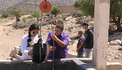 WPI students check a greywater recycling system, part of a fog harvesting initiative in Morocco.
