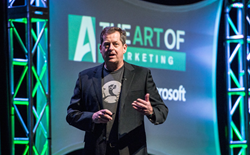 John Jantsch, Founder of Duct Tape Marketing, on stage and speaking at an event.