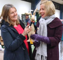 Maggie Andrews and Lucy Worsley admire Cuthbert Rabbit at a WI Market during filming of the BBC2 programme