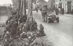 Belgian soldiers take a rest by the roadside