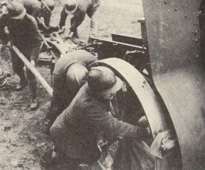 French soldiers moving a heavy artillery gun