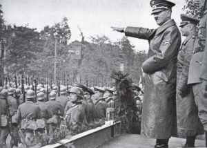 Hitler at the victory parade in Warsaw.