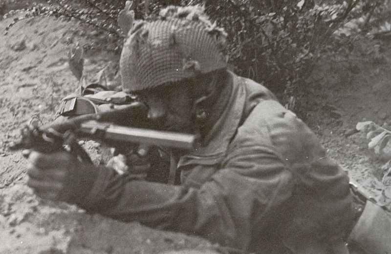 British paratrooper using his Sten gun Mark 5