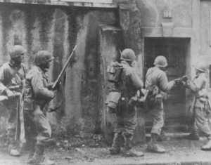 Us soldiers check houses at Metz for enemy 'stay-behinds'.