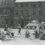GIs from the 7th Armored Division take a watchful rest in the streets of St Vith
