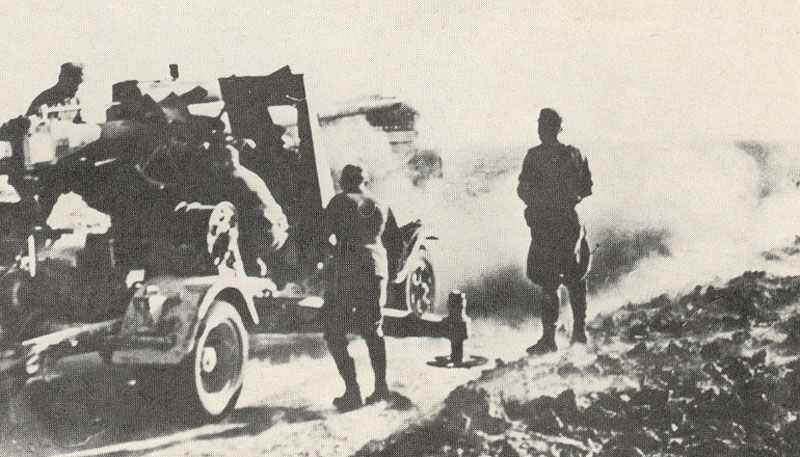 German 88mm Flak 36 in North Africa at the moment of firing.