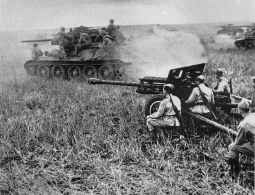 Russian T-34 tanks and fieldguns in action.