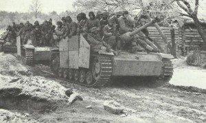 StuG III with mounted infantry