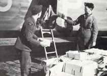 loading leaflets in a RAF bomber.