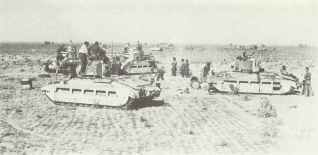 Matilda II tanks of 7 RTR refuel, replenish ammunition and repair minor damage at a 'Forward Rally Point' during Sidi Barrani operation in Libya of December 1940. The broken track on the tank to the right is mine damage.
