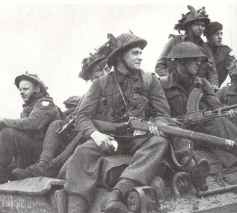 British troops, armed with Lee-Enfield rifles