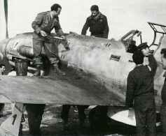 Ground crew prepare a C205V of the ANR for another sortie