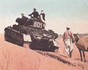 Panzer IV of the Afrika Korps is climbing a sand dune