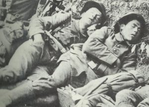 Exhausted soldiers holding a short sleep