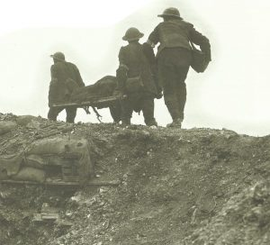 British stretcher-bearers carry a wounded soldier away