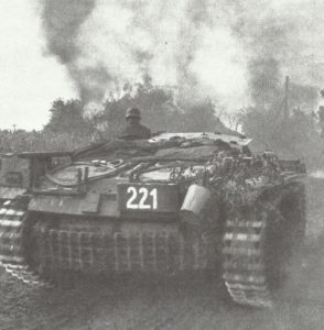 StuG fighting in village