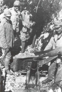 Loading an Italian  58mm trench mortar