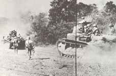 Japanese light tanks with infantry are advancing towards Manila
