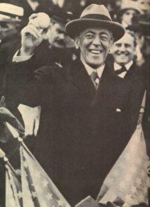 US President Wilson holding a baseball at a World series match