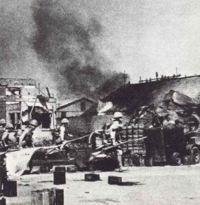 Japanese soldiers capture the railway station of Rangoon.